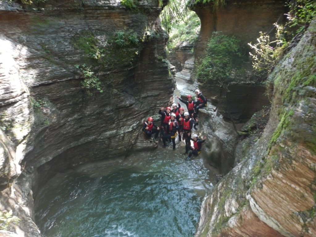 group of people canyoning in dolomites